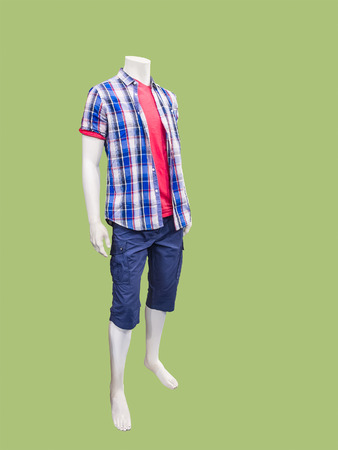 male mannequin: Male mannequin dressed in casual clothes against green background Stock Photo