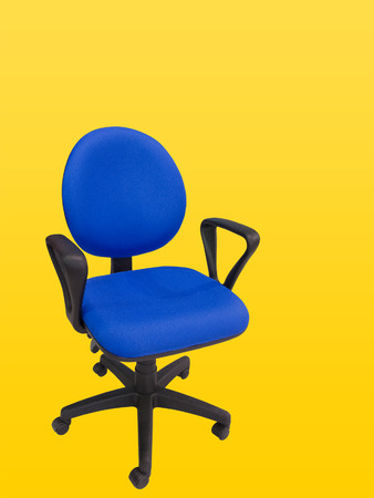 swivel: Close-up of an office swivel chair isolated against yellow background