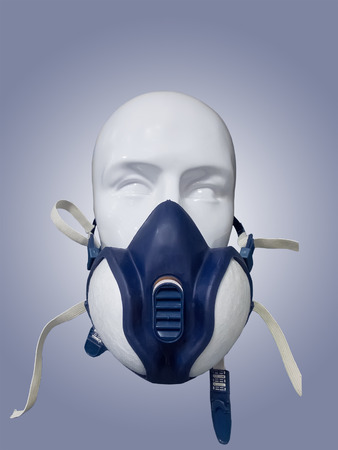 dust mask: Plastic mannequin wearing protective dust mask with valve