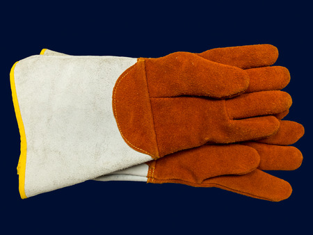 working gloves: Pair protective working gloves against blue background Stock Photo