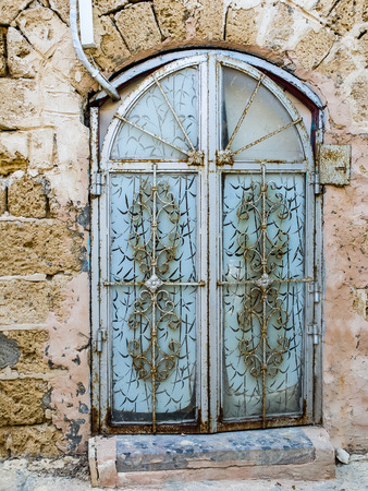 yaffo: Ancient door with a decorative lattice in the city of Jaffa, Israel