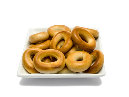 baranka: Russian traditional bagels on the plate isolated on white background.