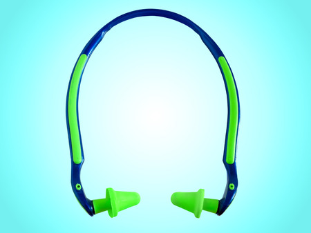hearing protection: Hearing protection ear plugs against blue background
