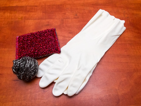 rubber gloves: Cleaning kitchen sponges and rubber gloves on a table. Top view. Stock Photo