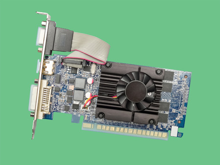 pci card: Video card with three outputs on a green background. Top view.