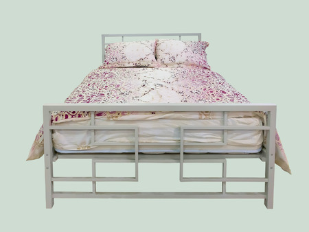 wooden bed: Wooden bed with blanket and cushions, isolated.