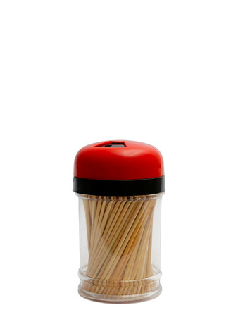 twist cap: Set of toothpicks in container on the white background.