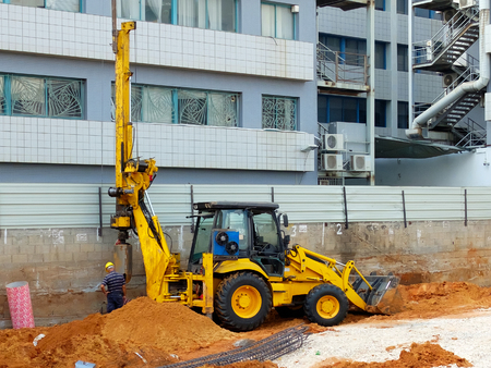 piling: Bulldozer with bore pile rig at the construction site during the foundation work.