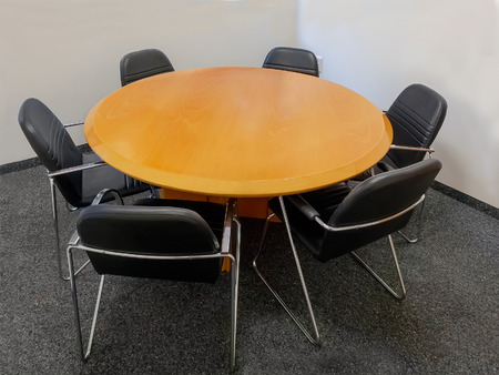 boardroom: Meeting table and black chairs in boardroom
