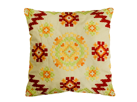 Decorative pillow with a pattern of colored threads embroidered. Isolated on white background. Reklamní fotografie