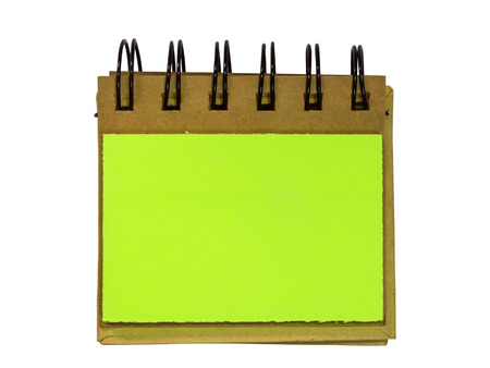 sticky notes: Blank sticky notes stuck to spiral notebook isolated on white. Stock Photo