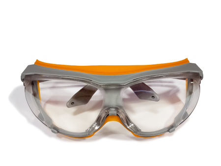 safety goggles: Plastic industrial safety goggles isolated on white background