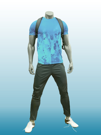 mannequin: Male mannequin wearing sport athletics clothes over blue background