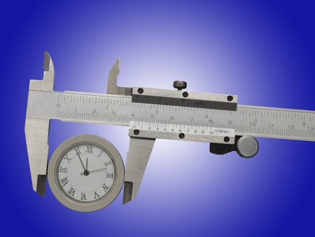 trammel: Measurement of watches with a caliper. Isolated on blue background