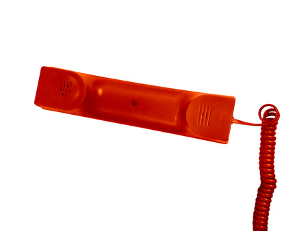 telephone receiver: Red telephone receiver with cable isolated on green background.