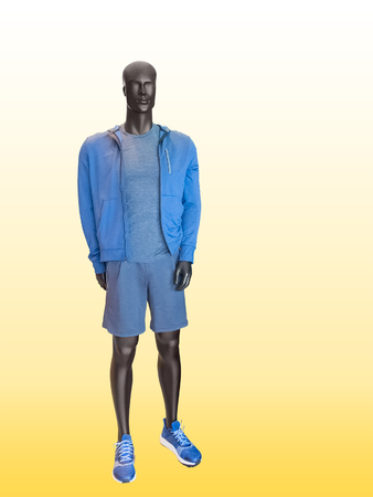 male mannequin: Male mannequin wearing clothes for sport end rest over yellow background Stock Photo