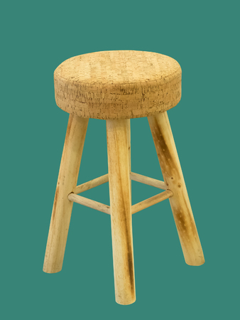 Bar padded wooden stool isolated on a green background