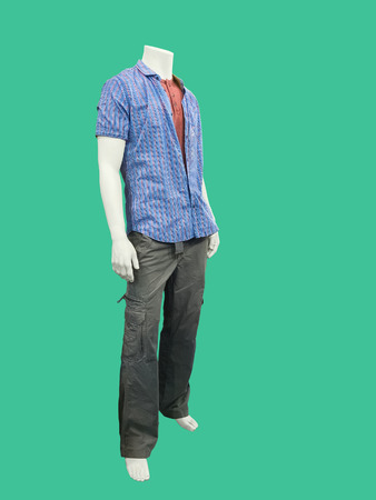 male mannequin: Male mannequin dressed in casual clothes.  Isolated on green background. No brand names or copyright objects.