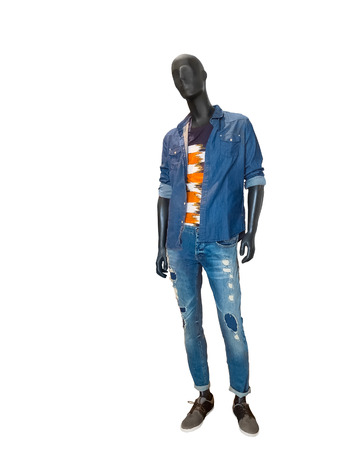 male mannequin: Full length male mannequin dressed in blue denim shirt and jeans, isolated on white. No brand names or copyright objects.