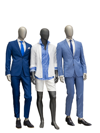 Three man mannequins dressed with fashionable modern clothes, isolated on white background. No brand names or copyright objects.