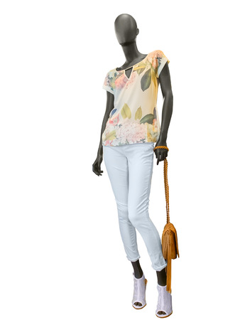 beautiful dress: Female clothing on a mannequin with handbag on white background. No brand names or copyright objects.