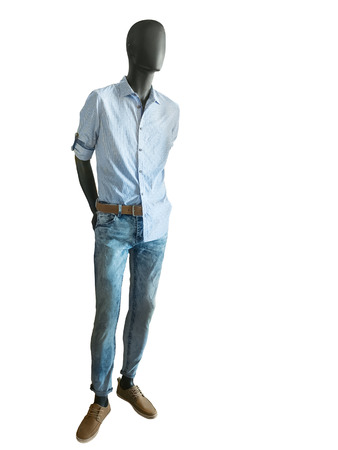 male mannequin: Full length male mannequin dressed in checkered shirts and jeans on white background. No brand names or copyright objects. Stock Photo