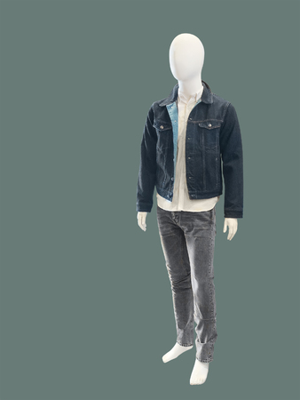 Contemporary elegant fashion apparel on male mannequin, isolated. No brand names or copyright objects. Stock Photo