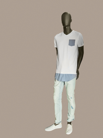 male mannequin: Full length male mannequin dressed in t-shirt and jeans, isolated. No brand names or copyright objects.