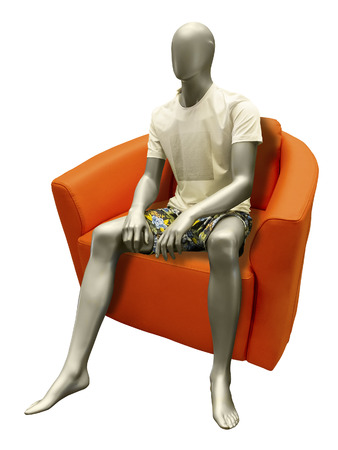 male mannequin: Sitting male mannequin wearing summer dress. Isolated on white background.  No brand names or copyright objects.
