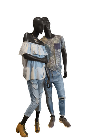 Two mannequins, male and female, dressed in casual summer clothes. Isolated on white background. No brand names or copyright objects. Stock Photo