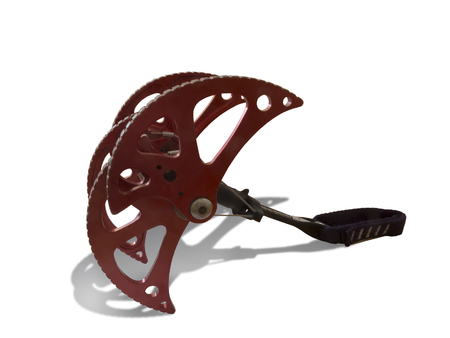 Spring-loaded climbing device. SLCD, cam or friend. Rock climbing protection equipment.  Isolated on white background.