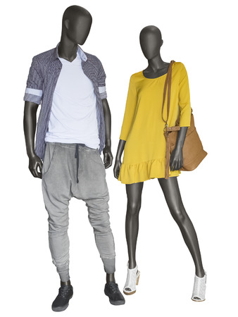 opentoe: Two mannequins, male and female, dressed in casual clothes. Isolated on white background. No brand names or copyright objects. Stock Photo