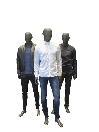 three objects: Three full length male mannequins dressed in casual clothes isolated on white background. No brand names or copyright objects. Stock Photo