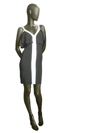 Full length female mannequin, dressed in black summer dress isolated on white background. No brand names or copyright objects. Stock Photo