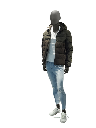 Full-length male mannequin dressed in warm jacket and blue jeans, isolated on white background. No brand names or copyright objects.