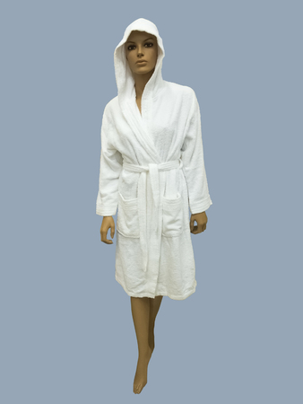 Female mannequin wearing white bathrobe with a hood. Isolated on gray background.