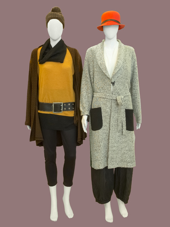 Two female mannequins dressed with fashionable warm clothes, isolated. No brand names or copyright objects.