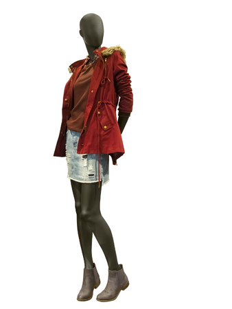 Full-length female mannequin dressed in red warm jacket. Isolated on white background. No brand names or copyright objects. Stock Photo
