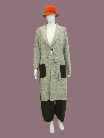 Full-length female mannequin dressed with fashionable warm clothes, isolated. No brand names or copyright objects.