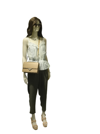 Full-length female mannequin dressed in fashionable clothes, isolated on white background. No release required. No brand names or copyright objects.