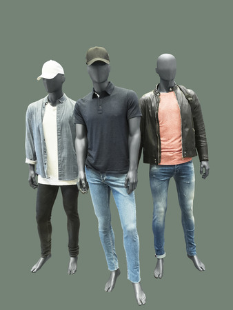 Three man mannequins dressed in casual clothes, isolated. No brand names or copyright objects.