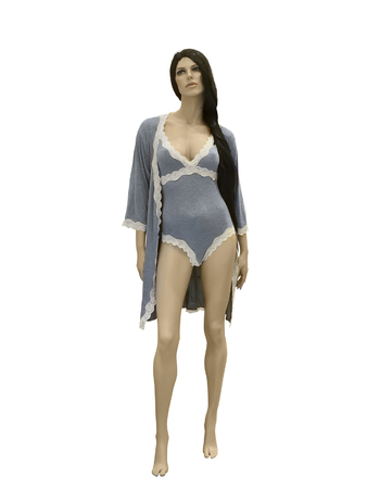Full-length female mannequin in nightwear. Isolated on white background. No release required. No brand names or copyright objects. Stock Photo