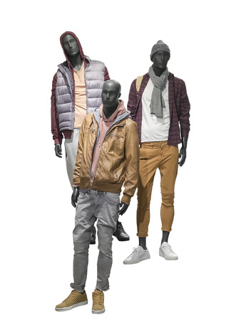 Three man mannequins dressed in casual clothes, isolated on white background. No brand names or copyright objects. Stock Photo