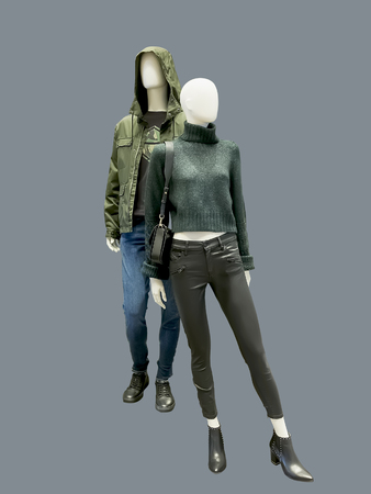 Full-length two mannequins, male and female, dressed in casual clothes, isolated. No brand names or copyright objects.