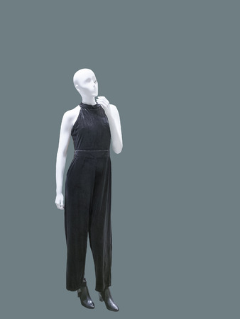 Full-length female mannequin wearing   fashionable overalls, isolated. No brand names or copyright objects.