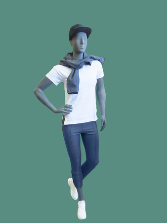 Full-length female mannequin dressed in sportswear, isolated on green background.  No brand names or copyright objects. Stock Photo