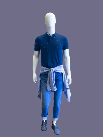 Full length male mannequin dressed in short sleeve shirt and blue jeans, isolated. No brand names or copyright objects. 写真素材