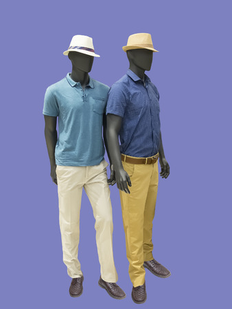 Two full-length male mannequins dressed in casual clothes, isolated. No brand names or copyright objects.