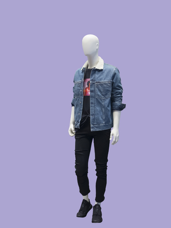 Full-length male mannequin dressed in warm jeans jacket. Isolated .No brand names or copyright objects.
