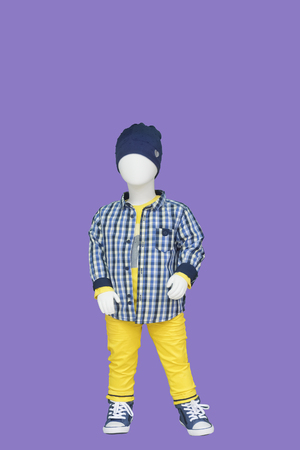Full-length child mannequin dressed in casual kids wear, isolated. No brand names or copyright objects.